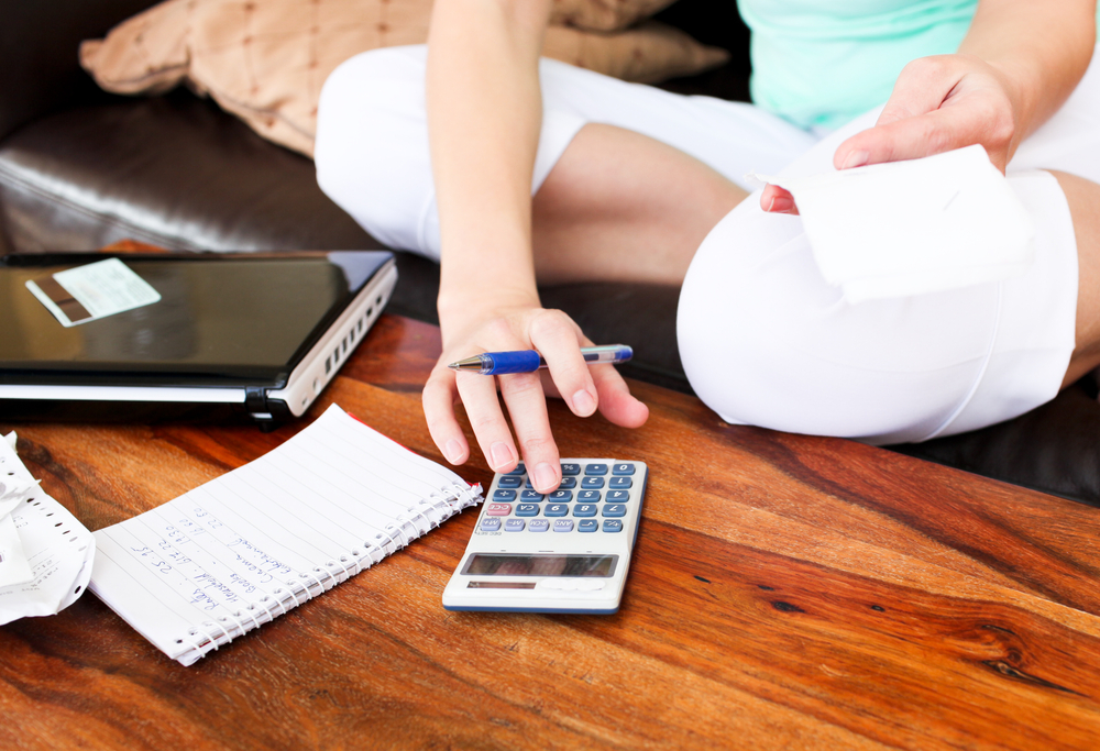 Beautiful woman doing accountancy at home