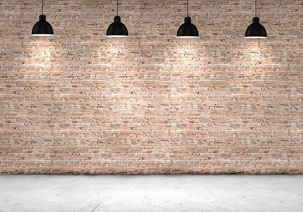 Blank brick wall with place for text illuminated by lamps above