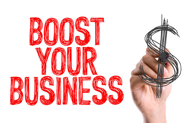 Hand with marker writing Boost Your Business-1