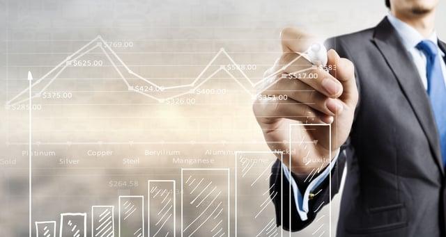 Businessman hand drawing increasing graph on media screen