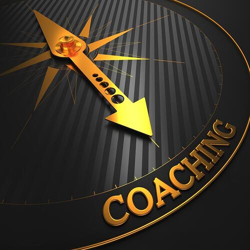 """Coaching - Business Background. Golden Compass Needle on a Black Field Pointing to the Word """"Coaching"""". 3D Render."""