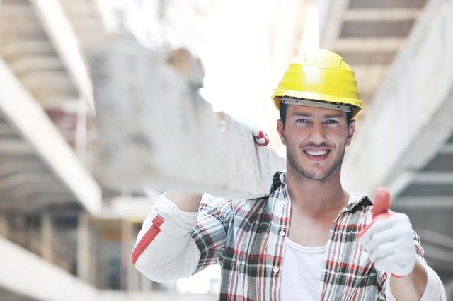 handsome hard worker people portrait at concstruction site.jpeg